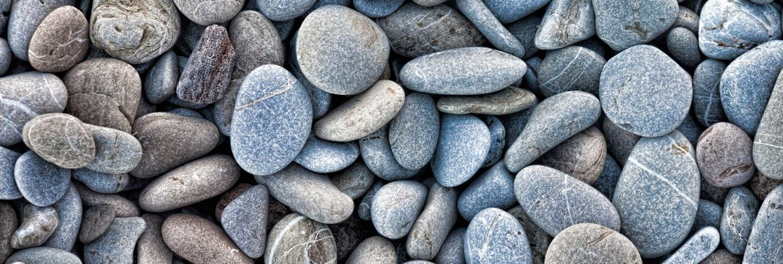a collection of beach rocks and pebbles