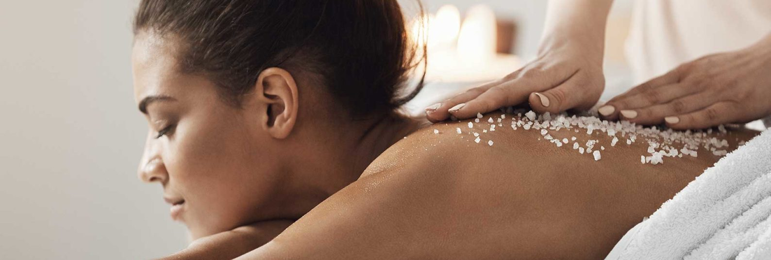 a woman getting a sea salt scrub massage